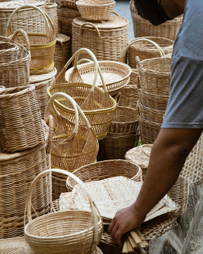 Man working in basket for sale at market