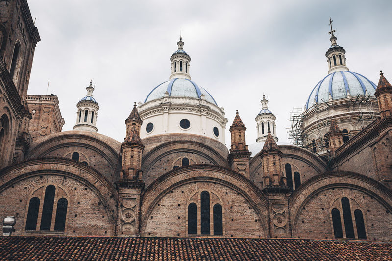 Azuay Catedral Cathedral Architecture Brick Walls Building Exterior Built Structure Catholic Church Church Dome Cloud - Sky Day Dome No People Outdoors Place Of Worship Religion Sky Spirituality Tiled Roof  Travel Destinations This Is Latin America The Architect - 2018 EyeEm Awards