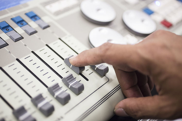 Cropped Hand Operating Sound Mixer