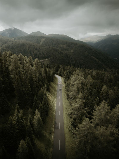 drone photo of the nockalmstrasse in austria wit ha car Tree Plant Mountain Sky Cloud - Sky Transportation Beauty In Nature Nature Scenics - Nature No People Mode Of Transportation Growth Road High Angle View Non-urban Scene Day Forest Tranquility Motor Vehicle Environment Outdoors Drone  Aerial View Trees Alps