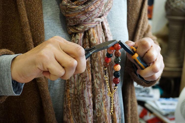handmade jewelry Handmade Handmade Jewellery Jewelry Jewellery Jewelry Store Jeweller Hand Hands Work In Progress Art Art And Craft ArtWork Jewel Close-up Human Hand Working Workshop Skill  Occupation Midsection Business Finance And Industry Craftsperson Thread Stitching