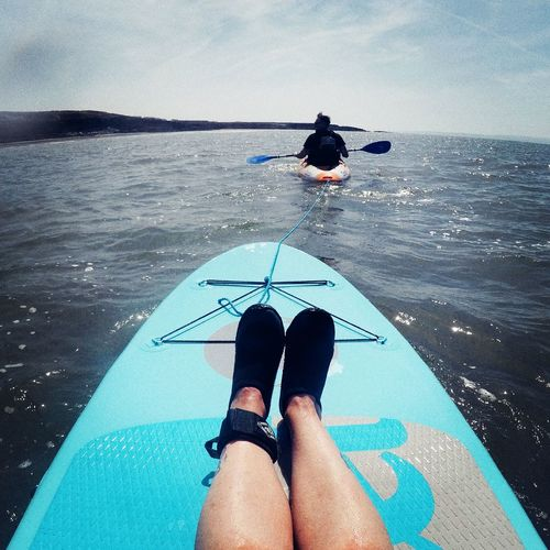 The secret to SUPing... getting a kayak tow out past the waves :) Watersports Lazy Day Stand Up Paddle Boarding Stand Up Paddling Sup Sea Kayak Vitaminsea Seaside Water Sea Real People Lifestyles Horizon Over Water Personal Perspective Leisure Activity Outdoors