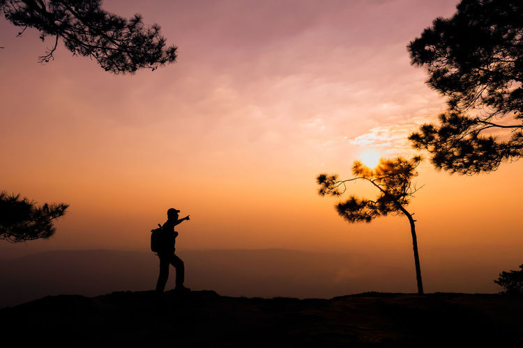 phalomsak view point Sunset Sky Silhouette Beauty In Nature Real People Orange Color Standing Tree Scenics - Nature Leisure Activity Plant Nature Photography Themes Photographing One Person Lifestyles Cloud - Sky Tranquility Activity Outdoors Photographer Digital Camera