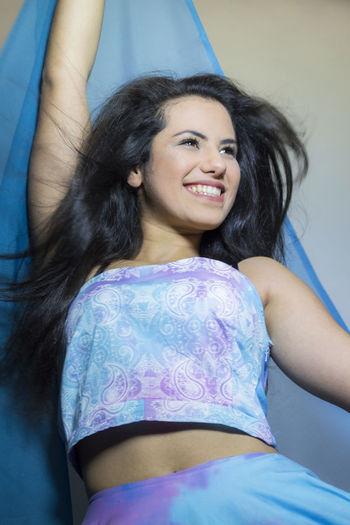 Beautiful happy young woman posing