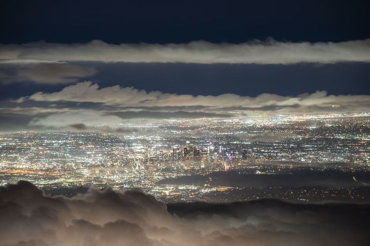 Aerial view of cityscape against sky at night