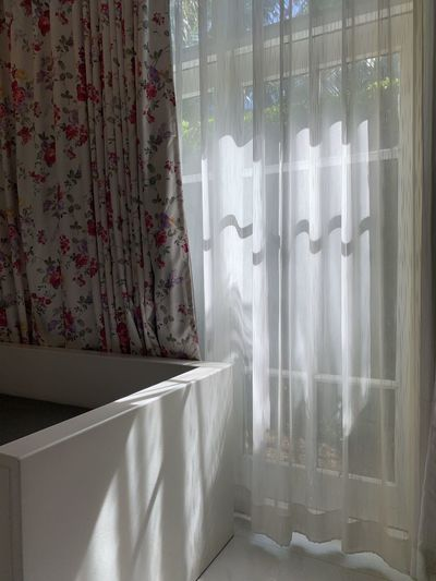White curtain hanging on window at home