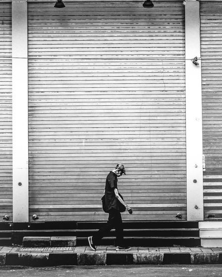 The Street Photographer - 2019 EyeEm Awards Streetphotography Street Photography Street Fashion Streetlife The Minimalist - 2019 EyeEm Awards City Full Length Corrugated Iron Men Side View Shutter Child Standing Built Structure The Minimalist - 2019 EyeEm Awards