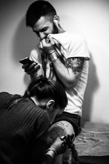 Two People Tattoo Tattooartist  Tattoo Life Tattooartist  Tattooed Tattoos Tatt Tattooing Hairdresser Barber Cutting Hair Men Adult Hairstyle Indoors  Only Men People Adults Only Combing Sitting Domestic Animals Real People Young Adult Working
