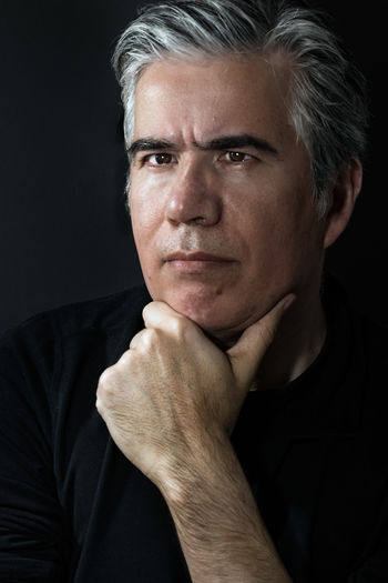 Portrait Studio Shot Black Background One Person Headshot Indoors  Mature Adult Adult Gray Hair Men Looking At Camera Front View Contemplation Serious Hand On Chin Close-up Mature Men Males  Baby Boomer