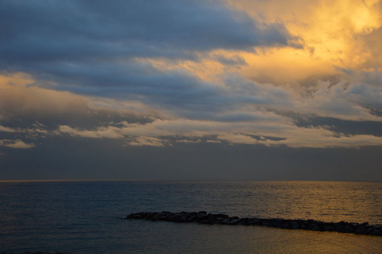 Sunset on the Mediterranean sea from the viewpoint of italy, with cloudy sky Colored Mediterranean Sea Mediterranean Seascape Sunset On The Mediterranean Sea From The Viewpoint Of Italy, With Cloudy Sky Vivid Colours  Beauty In Nature Cloud - Sky Cloudy Sky Background Horizon Horizon Over Water Italy Landscape Motley Nature No People Reflections Reflections In The Water Sea Sea And Sky Seascape Sky Stained Sundown Sundown Landscape Sunset