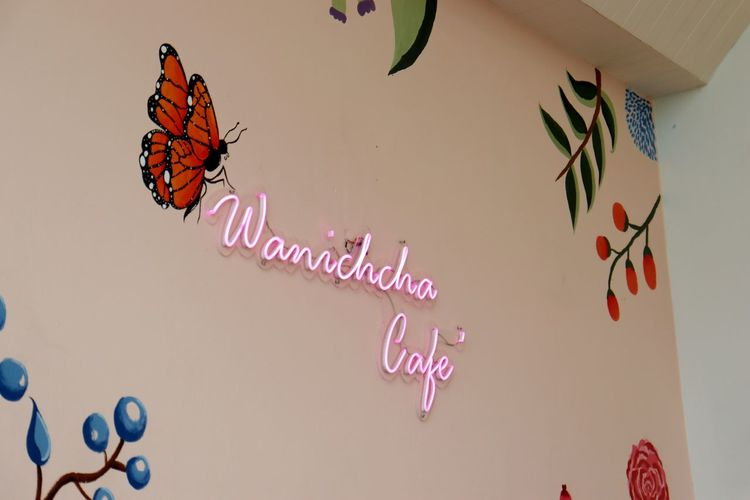 Low angle view of butterfly on pink wall