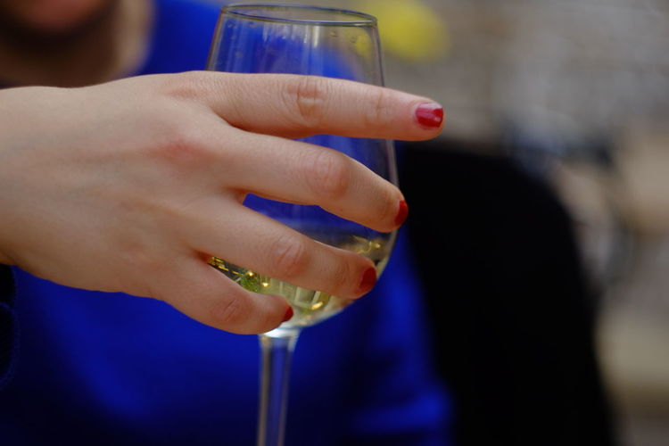 Cropped hand of woman holding wineglass