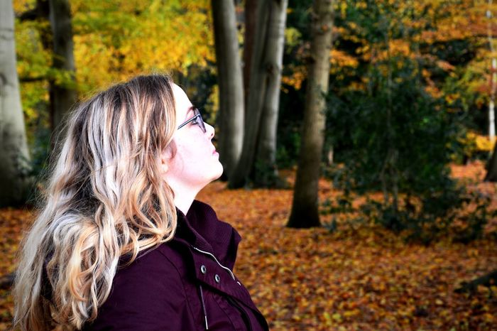 One Person Tree Mid Adult Real People Mid Adult Women Focus On Foreground Autumn Side View Headshot Leisure Activity Nature Outdoors Day Young Women Young Adult Tree Trunk Lifestyles Blond Hair One Woman Only Adult