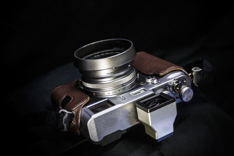 High angle view of camera on table against black background