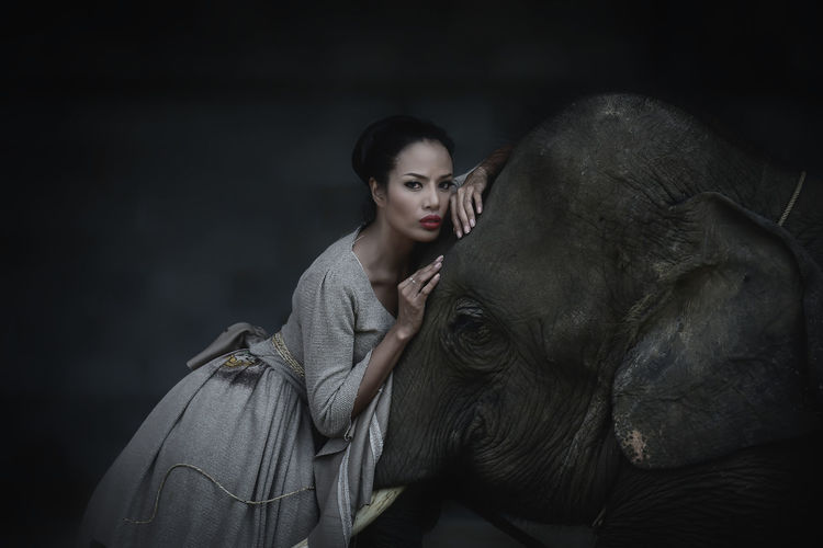 Adult Animal Themes Beautiful Woman Day Domestic Animals Elephant Horse Indoors  Lifestyles Mammal One Animal One Person People Pets Real People Young Adult Young Women