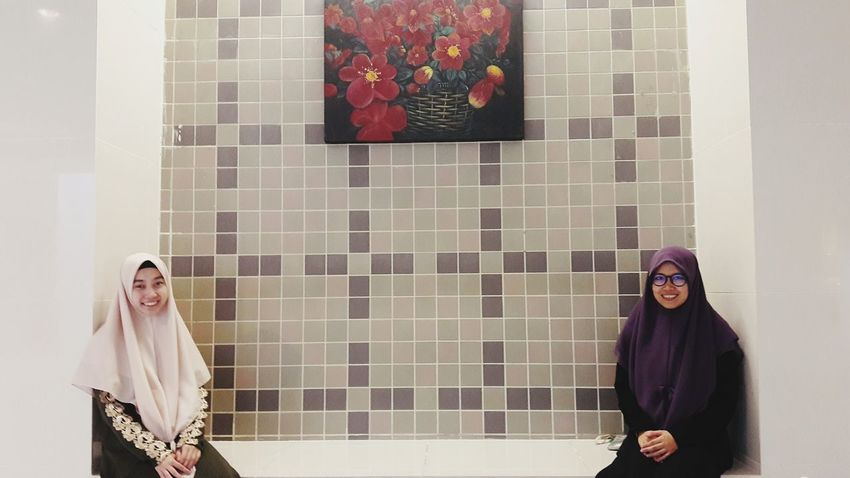 Standing Wall - Building Feature Indoors  Waist Up Casual Clothing Young Adult Young Women Tile Looking Person Well-dressed In Front Of Flower People And Places TakeoverContrast Minimal Women Around The World Breathing Space