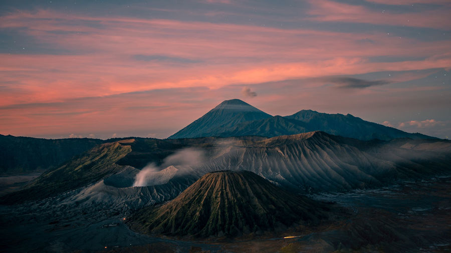 Beautyfull sunrise at Mount Bromo, on of the active Vulcvanos at Java INDONESIA Bromo-tengger-semeru National Park Vulcanic Landscape Vulcano Mount Bromo Scenics - Nature Beauty In Nature Tranquility Cloud - Sky No People Nightsky Environment Travel Destinations Idyllic Tranquil Scene Non-urban Scene Sunset Landscape Mountain Range Land Volcanic Crater Outdoors Mountain Peak Power In Nature Java