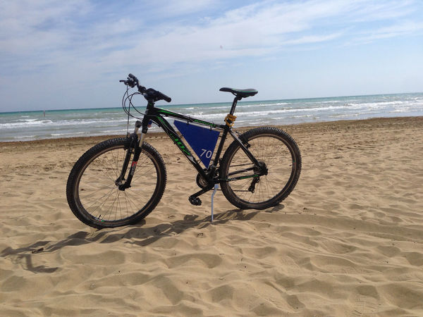 Beach Beauty In Nature Bicycle Cloud - Sky Horizon Horizon Over Water Land Land Vehicle Mode Of Transportation Nature No People Sand Scenics - Nature Sea Sky Stationary Tranquil Scene Tranquility Transportation Water