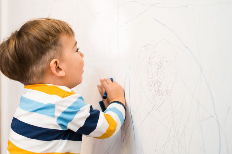 Childhood Child Boys Males  Men One Person Holding Indoors  Board Side View Art And Craft Standing Waist Up Offspring Creativity Innocence Wall - Building Feature Looking