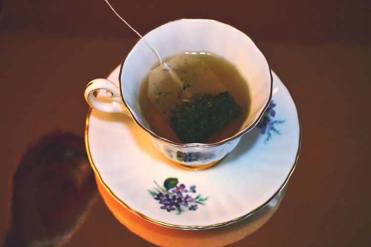 Close-up of herbal tea with tea bag on table