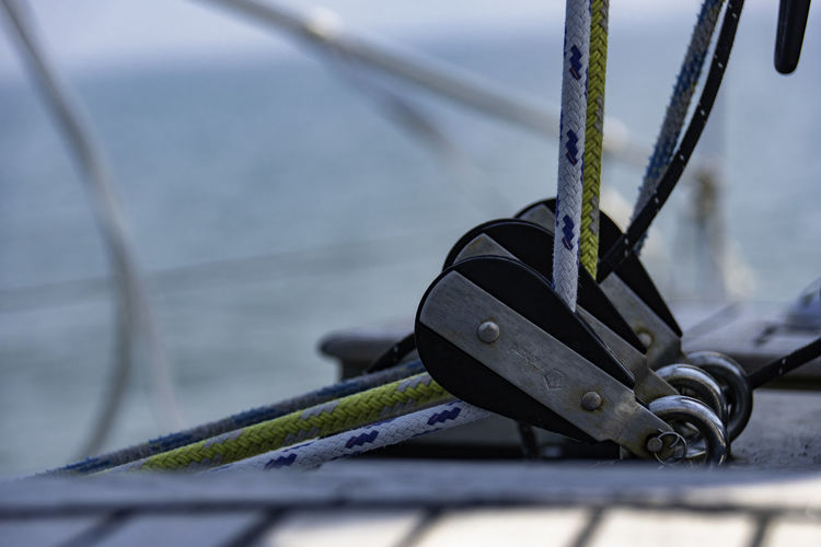 Close-up of rope tied to pulley on boat