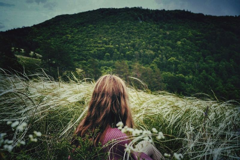 EyeEmNewHere Outdoors Nature Long Hair Grass Day Landscape Beauty In Nature Sky People