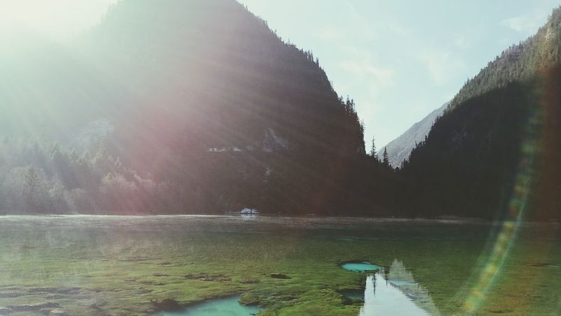 Snow Hill Mountains Sun Abaprovince Jiuzhaigou Beauty In Nature China Cold Nature Tree Sky Glares Winter Lake Day Clearwaters  Finding New Frontiers