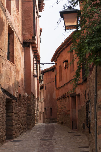 Little Alley in Albarracin, Teruel. An arab founded village in Spain ©alexander h. schulz Albarracín Pink Red SPAIN Teruel Alley Arab Architecture Building Exterior Built Structure Day Historic Lamp Mountains No People Outdoors Stone Tiles Travel Destinations Village Walkway