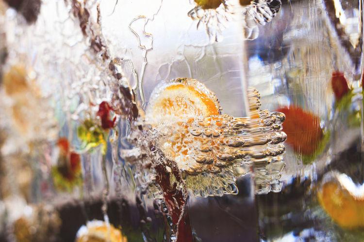Frozen orange and cinnamon in glass