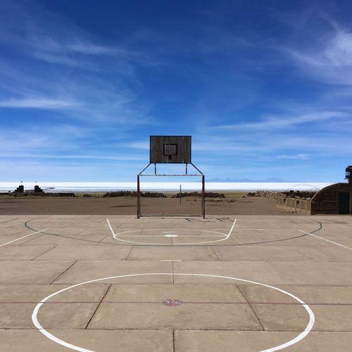 Basketball court against beach