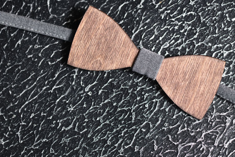 Stylish men's brown wooden bow tie with gray fabric on an iron rough surface. Accessory for brutal men Rough Texture Gray Element Cravat Clothes Cloth Classic Tie Bow Tie Accessory Wood - Material Wedding Style Modern Fashion Mensfashion Handmade Design Brown Apparel Single Object Mature Men Male Event Closeup Casual Clothing Business Vintage Style Bowtie Wear Elegant Clothing Retro Backgrounds Wooden Brutal Surface Metal