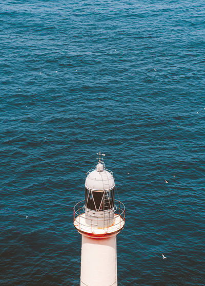 High angle view of lighthouse in sea