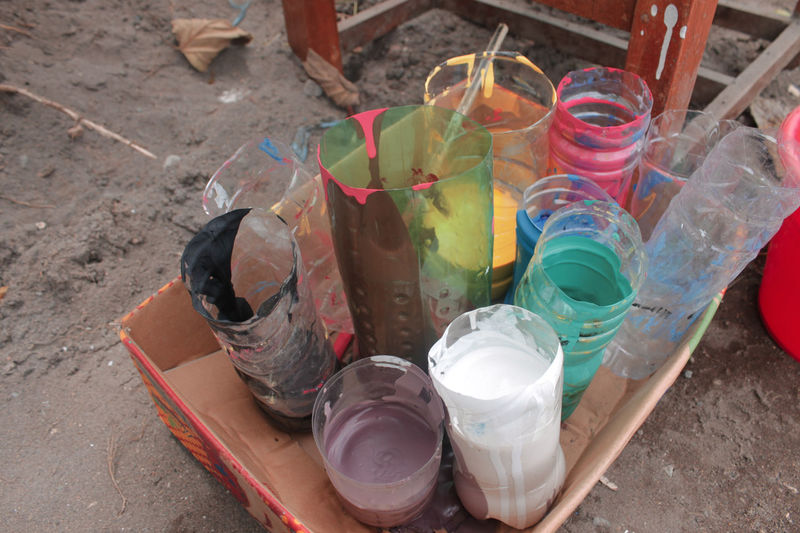 High angle view of various bottles in container