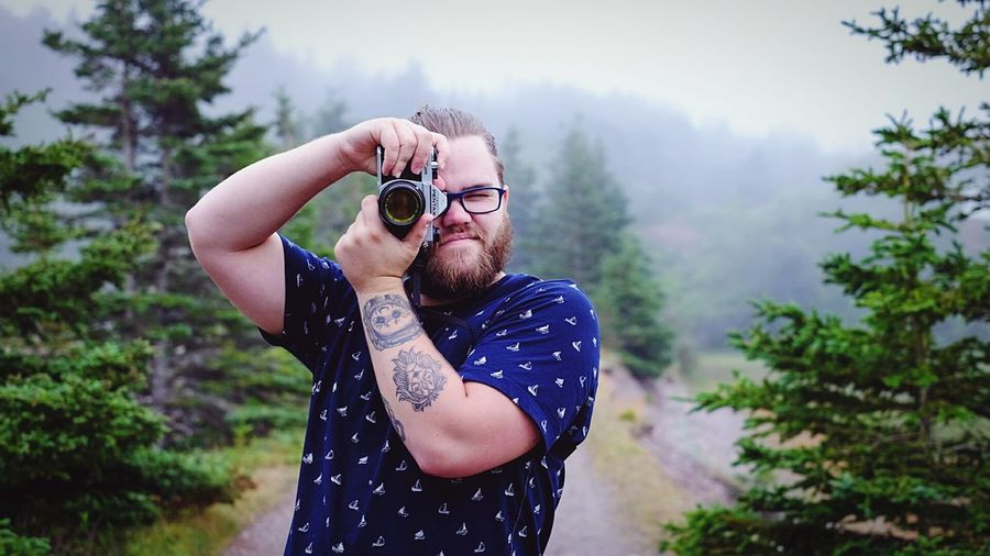Lifestyles Holding Tree Mountain Camera - Photographic Equipment Young Adult Non-urban Scene Scenics Casual Clothing Nature Outdoors Pentax K1000 New Brunswick, Canada