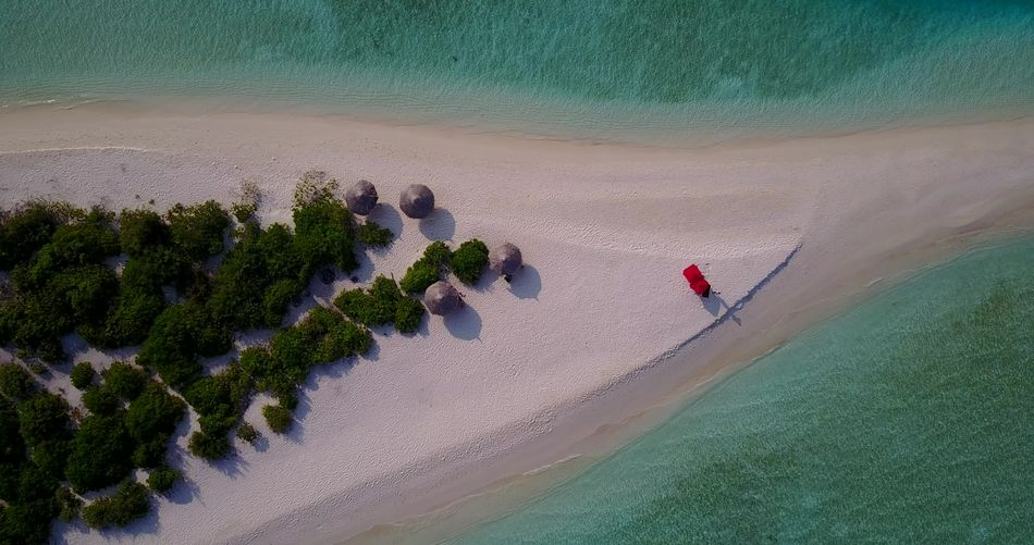 Aerial flying drone view of Maldives white sandy beach on sunny tropical paradise island with aqua blue sky sea Aerial View Beauty In Nature Drone  Flying Holiday Island Luxury Maldives Nature Ocean Paradise Relaxing Sandy Sea Summer Tropical Vacations White