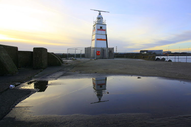OUT AND ABOUT IN HARTLEPOOL Water Sky Architecture Built Structure Building Exterior Tower Guidance Lighthouse Reflection Nature Building Direction Safety Security Sunset Protection Sea No People Puddle Outdoors