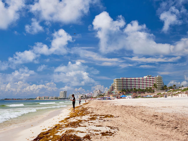 Caribbean beach and turquoise sea for a paradise landscape in Cancun, Playa delfines, Quintana Roo, Mexico Canon Cancun Mexico White Sand Beach Sky Sea Water Land Cloud - Sky Nature Architecture Building Exterior Built Structure Day Sand Incidental People Outdoors Beauty In Nature City People Real People Scenics - Nature Horizon Over Water