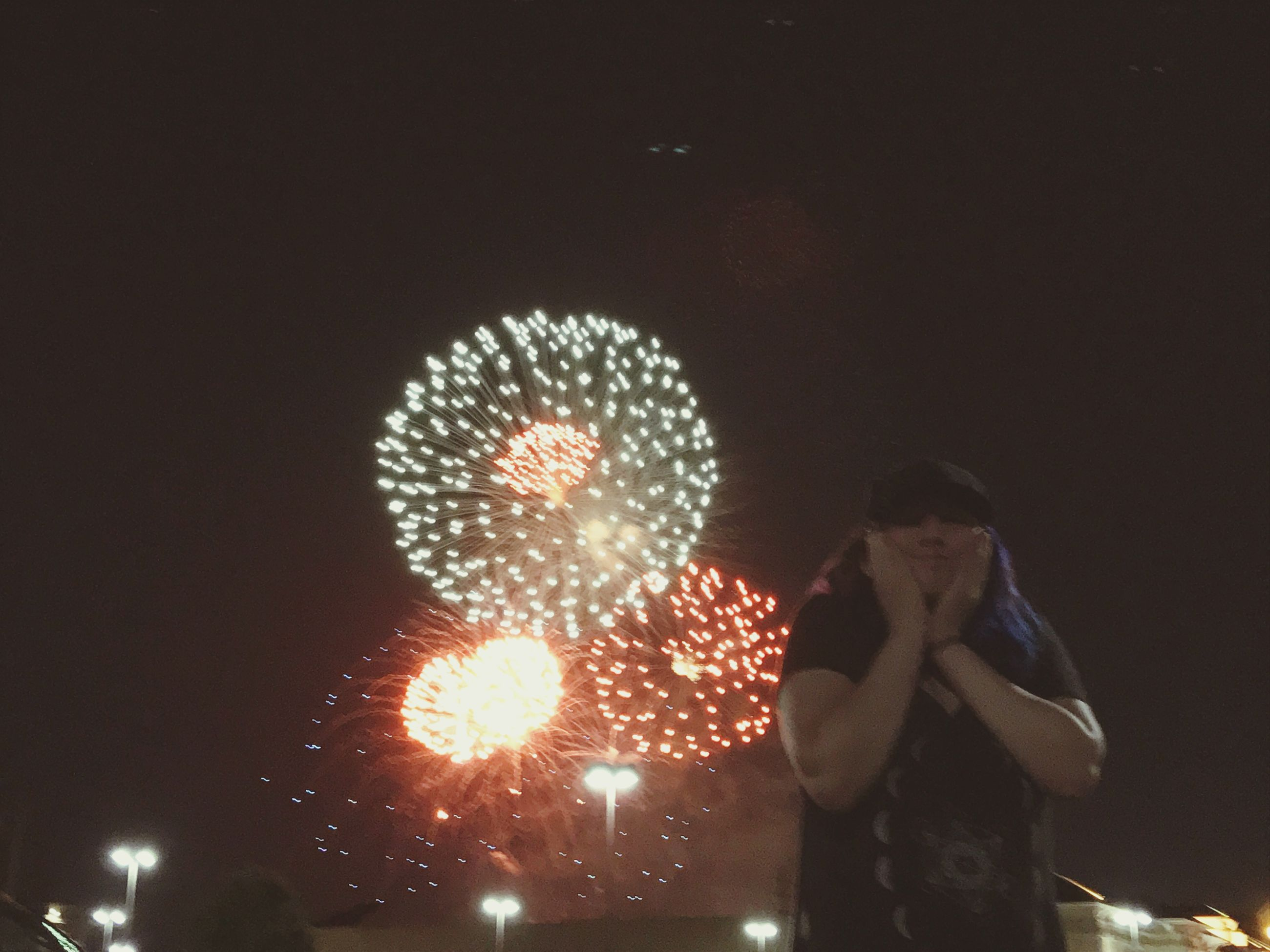 night, illuminated, one person, real people, arts culture and entertainment, motion, firework, long exposure, lifestyles, standing, glowing, men, leisure activity, event, celebration, blurred motion, holding, firework display, exploding, sparks, firework - man made object