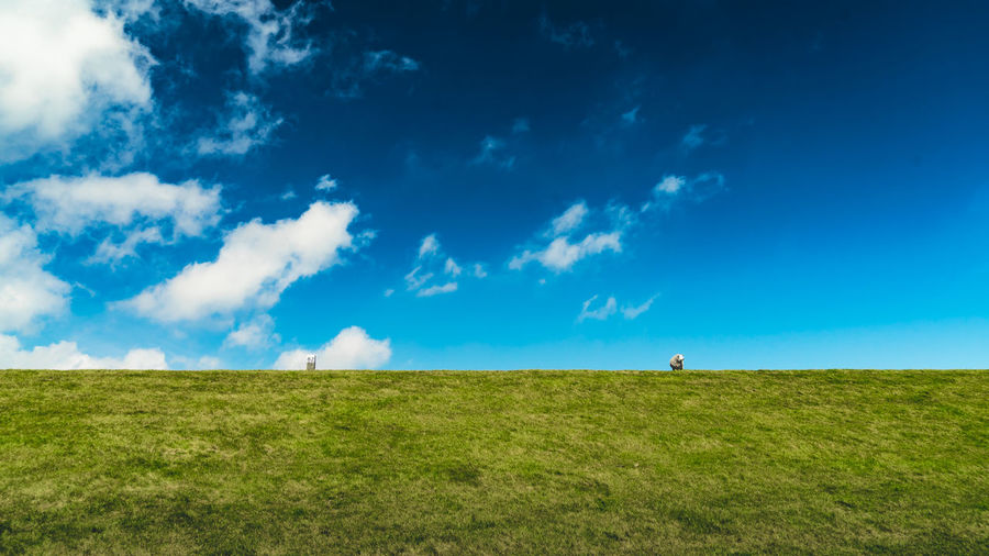 Beauty In Nature Blue Cloud - Sky Day Dike Dyke  Environment Field Grass Green Color Horizon Horizon Over Land Land Landscape Nature Non-urban Scene Outdoors Plant Scenics - Nature Sky Tranquil Scene Tranquility