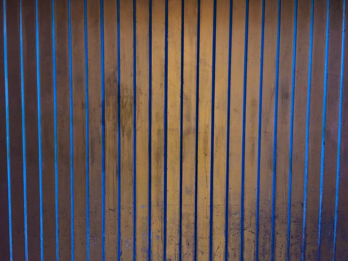 Full frame shot of wooden fence at night