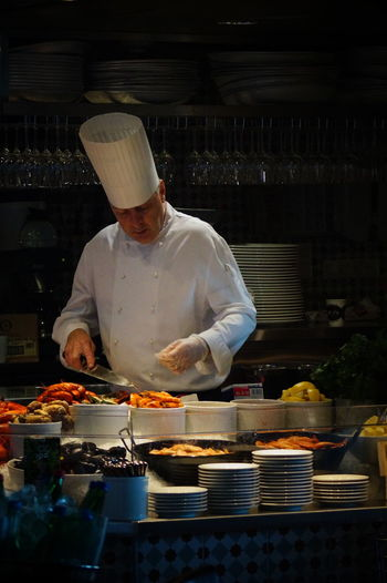 Chef Preparing Food In Restaurant