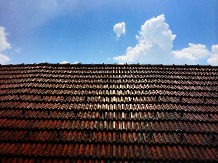 Roof tiles against sky