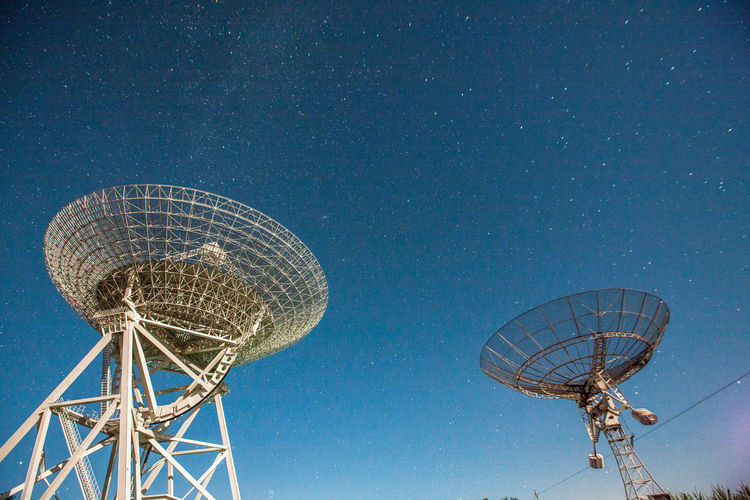 Astronomy Astronomy Telescope Built Structure Communication Connection Day Galaxy Global Communications Low Angle View Milky Way Nature No People Outdoors Research Satellite Dish Science Sky Space Space Exploration Star - Space Star Trail Technology Telecommunications Equipment Television Industry Wireless Technology