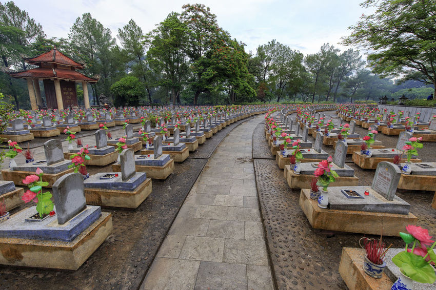 The Truong Son Cemetery in Vinh Tuong Commune, Gio Linh District, Quang Tri Province, Vietnam: July 26, 2018: This is a resting place for more than 60,000 martyrs killed in the Vietnam-US war. Gio Linh Quang Tri Truong Son Cemetery Viet Nam Vinh Tuong Absence Architecture Arrangement Built Structure Cemetery Day Grave Growth In A Row Large Group Of Objects Nature No People Outdoors Plant Religion Side By Side Sky Stone Tree