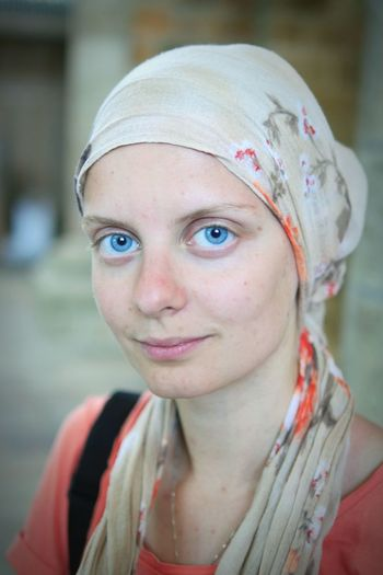 Close-Up Portrait Of Smiling Young Woman Wearing Headscarf