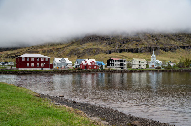 Iceland Iceland Memories Architecture Beauty In Nature Building Exterior Built Structure Day Fog Grass House Iceland Trip Iceland_collection Lake Landscape Mountain Nature No People Outdoors Rural Scene Scenics Seyðisfjörður Sky Water