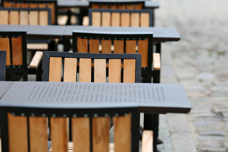 Close-up of empty chairs and tables in a restaurant