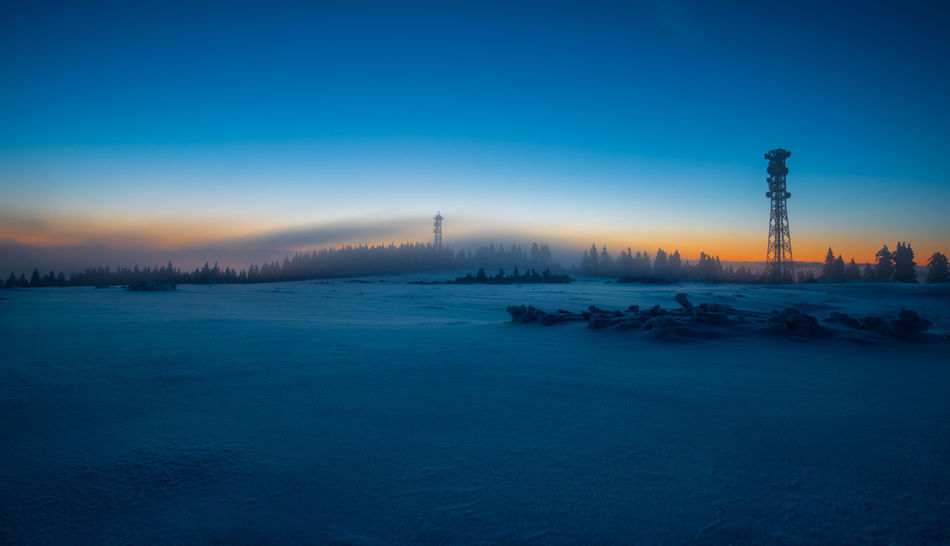 Architecture Beauty In Nature Blue Cold Temperature Day Drilling Rig Frozen Nature No People Outdoors Scenics Sky Snow Sunset Tranquil Scene Tranquility Tree Water Winter