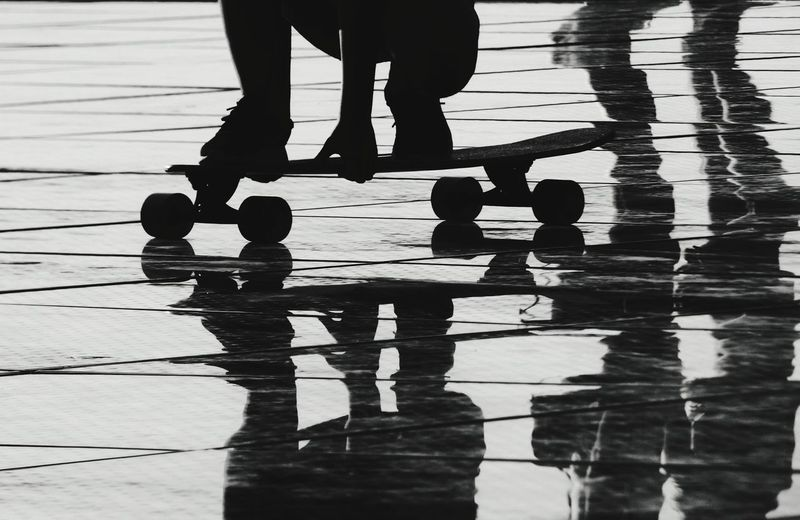 Girl skating into my shot Skate Skateboarding Zadar Croatia Summer Coast Bw Bw_collection People Dalmatia Streetphotography Girl Low Section Water Togetherness Human Leg Silhouette Sport Standing Reflection The Art Of Street Photography