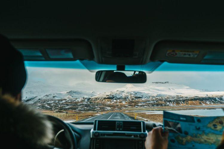 Interior view of man driving car